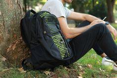 Black Backpack patterned in green.