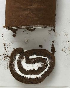 """Chocolate-rum swiss roll - Make this sweet Swiss roll from """"Martha Stewart's Cooking School"""" for an unforgettable holiday dessert. Also try: Jelly Roll Martha Stewart Cooking School, Chocolates, Dirt Cake, Bon Dessert, Holiday Desserts, Let Them Eat Cake, No Bake Cake, Cupcake Cakes, Rum"""