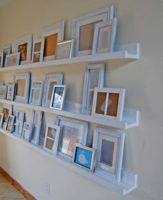 $10 diy ledges - instead of trying to rearrange frames nailed in the wall when you want to add a new one ***For above the fire place!