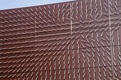 Windswept ... wind-driven kinetic facade that transforms a blank wall into an observational instrument that reveals the complex interactions between wind and environment.