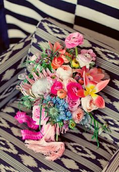 Gorgeous tropical wedding bouquet with fringe wrap and an awesome background