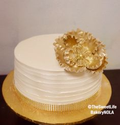 Simple cream gold flower custom cake by The Sweet Life Bakery New Orleans www.nolasweetlife.com email info@nolasweetlife.com (504)371-5153 #nolasweetlife @nolasweetlife