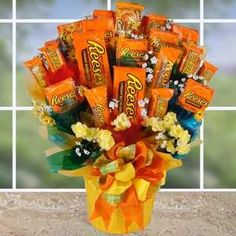 All candy gift bouquets are not created equal because this one ROCKS! It will Rock the office, Rock the dorm room, and even rock the house! Totally loaded with Rockin' Reese's this candy bouquet will Candy Bar Bouquet, Gift Bouquet, Craft Gifts, Diy Gifts, Chocolates, Candy Arrangements, Candy Gift Baskets, Candy Crafts, Candy Art