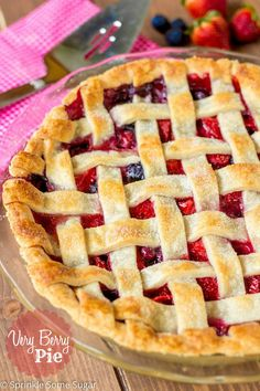 Very Berry Pie. A perfectly tender & flaky homemade pie crust filled with a sweet and gooey strawberry and blueberry filling!