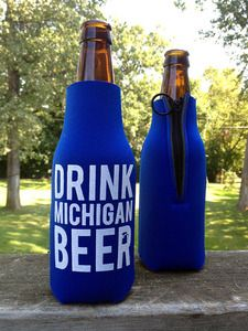 """If you're gonna enjoy a master-crafted Michigan beer, you'd better keep it cold! This """"Drink Michigan Beer"""" cozy ought to do the trick. Side zipper for easy installation onto your next bottle of Michigan's finest. Booze Drink, Michigan, Best Beer, Craft Beer, Brewery, Beverages, Cocktails, Cozy, Bottle"""