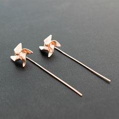 Rose gold earrings, unusual earrings, pinwheel earrings, windmill earrings, sterling silver stud earrings, rose gold jewelry, cute studs by emmanuelaGR on Etsy https://www.etsy.com/listing/115676022/rose-gold-earrings-unusual-earrings