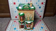 """Dept 56 Snow Village Series """"The Christmas Shop"""" #50970 used very nice condition"""