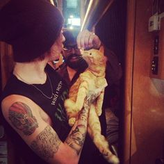 Alan Ashby with a stray cat found near Of Mice and Men tour bus <3