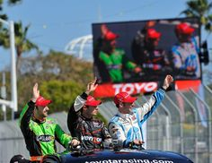 Will Power, winner of the 38th. Toyota Grand Prix of Long Beach, center, with third place James Hinchcilffe, left, and second place Simon Pagenaud, right, during a victory lap on Sunday, April 15, 2012. Jeff Gritchen/Long Beach Press-Telegram