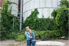 Engagement Photo Outfit Ideas. Blue green plaid, pink tie, green sweater, blue jeans. Industrial setting. Northeast Minneapolis, MN.  AmberRaePhoto_Engagement_Minneapolis_MN_0012.jpg