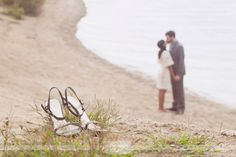 love this engagement photo with the bride and groom blurry with the shoes in focus!  from a rustic engagement photography shoot in concord, nh