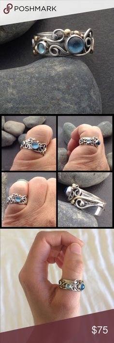 Elfinworks Blue topaz sterling silver ring Blue topaz sterling silver ring with brass details and three sky blue topaz stones. This is a one of a kind, artisan ring and is perfect for any occasion! In perfect condition! Jewelry Rings