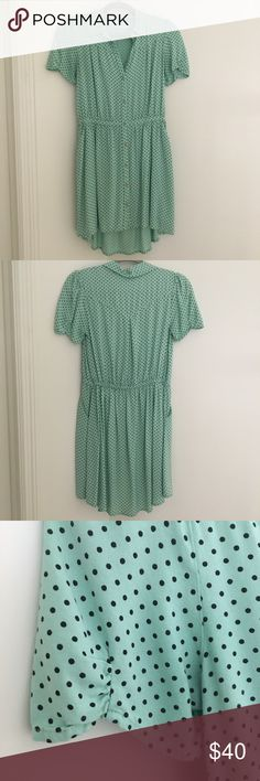 Urban Outfitters Kimchi Blue Polka Dot Dress Only worn 3 times, beautiful dress that's mint green with black polka dots. Has pockets! No flaws and price is firm. Urban Outfitters Dresses