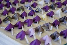 Escort card alternative. Or, i might just print fun fortunes on them. I really like the butterfly escort cards.