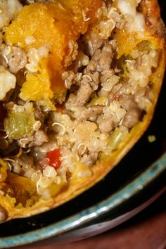 Quinoa Stuffed Acorn Squash... this is dinner TONIGHT.. minus the turkey