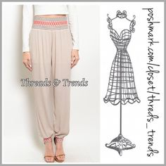 """Sabrina Genie Pants Stylish taupe genie pants featuring black & red stitching detail waistline and cuffed ankles. Made of rayon and lined. Size S/M M/L.                  Inseam on both sizes 31""""  S/M super stretchy & soft wide band elastic  waist 24"""" to 34""""  Rise 13"""" Hips 40""""  M/L  Waist 26"""" to 36"""" Hips 46"""" Rise 13"""" Threads & Trends Pants"""