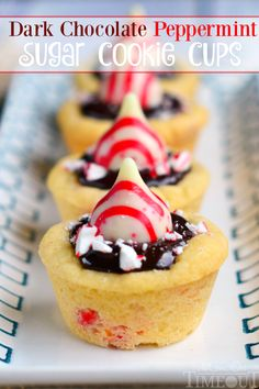 Dark Chocolate Peppermint Sugar Cookie Cups filled with chocolate ganache and topped with Candy Cane Hershey's Kisses. An easy treat that is perfect for the holidays!