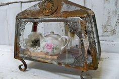 Love the contrast! Rusty ornate display box with delicate rose teapot. http://www.anitasperodesign.com/