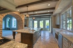 Love the brick arch and exposed beams. Lets be real. We cant afford this, but I do think we are DIY crafty enough to make some major, similar, upgrades ourselves! Brick Arch, Beautiful Kitchens, House Design, Future House, House, Building A House, House Plans, House Inspiration, New Homes