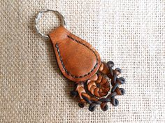 Items similar to Leather Keychain with Traditional Hungarian Sallang Braiding - Light Tan Color on Etsy Headstall, Leather Keychain, Household, Trending Outfits, Unique Jewelry, Handmade Gifts, Traditional, Etsy, Vintage