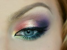 'Exotic Sunset' look by Aniqua using Makeup Geek's Corrupt, Mango Tango, Ocean Breeze, Peach Smoothie, Purple Rain, Sea Mist, Shimmermint, Unicorn, Wisteria, Yellow Brick Road eyeshadows along with Immortal gel liner!