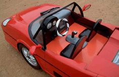 Have you dreamed of owning a Ferrari? Dream no longer... buy your own hand made African Ferrari today! Just look at the detail... And it opens into a chest to keep things in! A truly unique work of art!