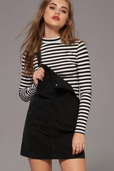 A stripe ribbed knit top with a mock neckline and long sleeves.