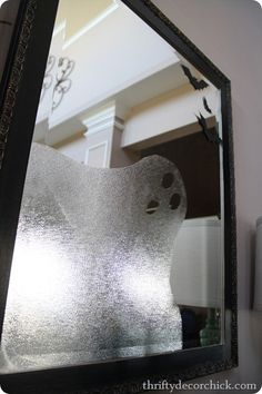 Instead of a ghost a halloween why not use clear contact paper and make snowflakes for your mirrors.