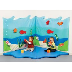 Sea World Wall Panel - A large, padded panel to fix to the wall to create a soft fabric background with detachable marine animals. The sea creatures stick to the fabric with Velcro so children can move them again and again. Use 2 panels to make a soft corner or several panels to create a large background. The panel has metal mounting eyelets for wall mounting with screws, (screws not provided.) Alternatively, fix to the wall with the Velcro tape provided.