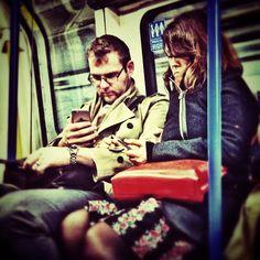 Love on the phone. London tube.