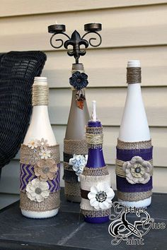 DIY Tiki Torches • Lots of Ideas and Tutorials! Including from 'glitter glue and paint', these decorative wine bottle tiki torches. #decoratedwinebottles #recycledwinebottles