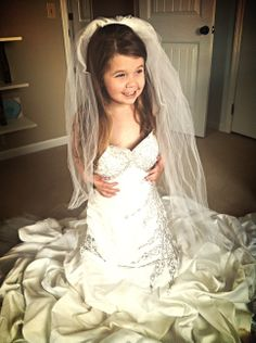 Photograph your daughter in your wedding dress to display at her wedding!
