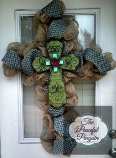 Saw a very pretty one similar to this on Duck Dynasty (theirs had leopard print & feather accents). Wonder how hard it is to find a cross shaped wreath frame? Burlap Mesh Cross Wreath with Green Tin by ThePeacefulPenguin Burlap Crafts, Wreath Crafts, Diy Wreath, Wreath Making, Wreath Ideas, Wreath Bows, Easter Crafts, Christmas Crafts, Christmas Decorations