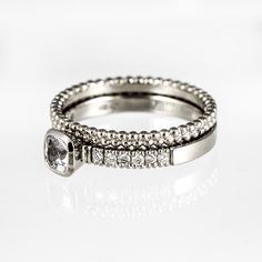 Wedding ring set for women. White sapphire, diamonds and white gold.