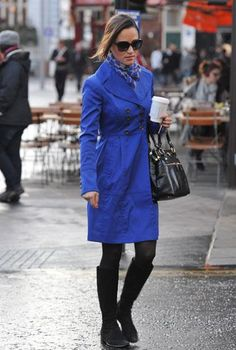 Pippa Middleton looked chic in a royal blue trench coat with a matching heart-patterned scarf in London.