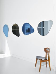 The varying concepts of reflection range from hanging, balloon-like chandeliers to oblong, blue-hued shapes inspired by the lunar cycle. Balloons, Shapes, Mirror, Gallery, Wall, Artwork, Inspiration, Surface, Minimalist