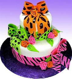 """Neon Animal Print Safari"" Cake by Tami Utley - What a bright, fun and easy cake to make! With some brightly colored fondant, a few brush strokes and some easy fondant roses, you can transform a simple layered cake into a eye-catching centerpiece!"