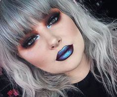 Bold alternative makeup  smokey eye and blue metallic  lips                                                                                                                                                                                 More
