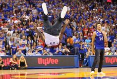 Kansas sophomore guard Frank Mason flips before ethe fieldhouse crowd during Late Night in the Phog on Friday, Oct. 10, 2014. #KU