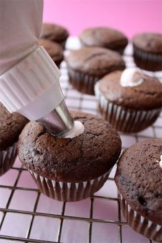 Cream filled cupcakes with homemade chocolate ganache frosting #recipe #cupcake