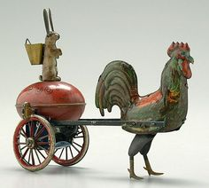 "chicken pulling rabbit sitting on egg, rabbit's ears move up and down, marked ""Lehmann"", original painted surface with minor chips and losses, one wheel and axle bent, working order except for one bent spoke that catches, 5 x 7 x 2-3/4"""