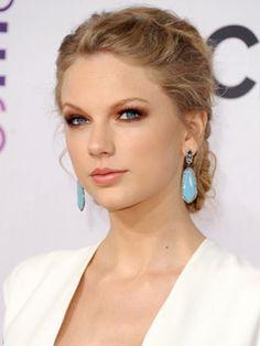 Taylor rocking a french braid with a twist via Cosmopolitan
