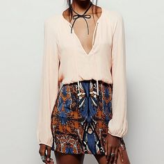 Free People Long  Sleeve Mini Long sleeve mini with a deep V-neckline and tie front. Skirt portion of dress is a beatific woven tapestry fabric. Fits true to size. ✔️No trades 👌🏽Bundle for a discount. Free People Dresses Long Sleeve