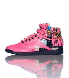 3bd7622d88e41 REEBOK Women s mid top sneaker Lace up closure with double velcro straps