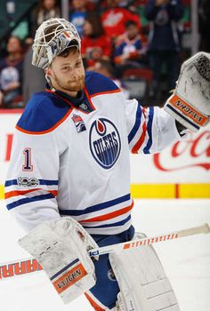 CALGARY, AB - JANUARY 21: Laurent Brossoit #1 of the Edmonton Oilers salutes the crowd after a win against the Calgary Flames at Scotiabank Saddledome on January 21, 2017 in Calgary, Alberta, Canada. (Photo by Gerry Thomas/NHLI via Getty Images)