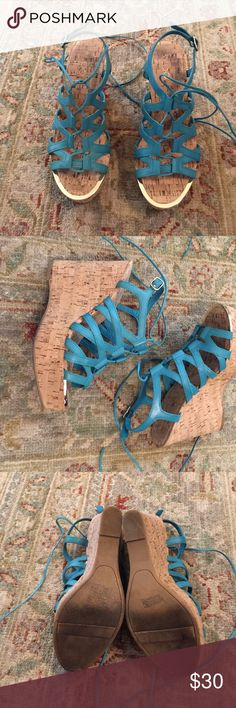 """Aldo Wedge Sandals EUC Beautiful turquoise leather sandals with cork bottoms. Buckles around ankle and also wraps and ties around ankle. Gold trim at toe edge. Has 4 1/2"""" heel in back. Platform part under front of foot is 1 1/2"""" tall. Only worn a couple times. No flaws. ALDO Shoes Wedges"""