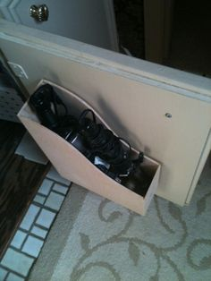 DIY Bathroom Storage via The Suels Ikea magazine holder turned into curling iron storage..love it!