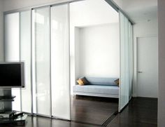 Frosted glass with silver frame as a room divider