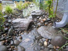 Rain Rock Garden Feature Utilizes Water From Downspout