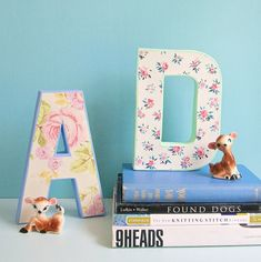 To make these sweet letters, you'll want to scour Etsy for vintage wallpaper scraps.  Get the tutorial at My So Called Crafty Life »  - GoodHousekeeping.com